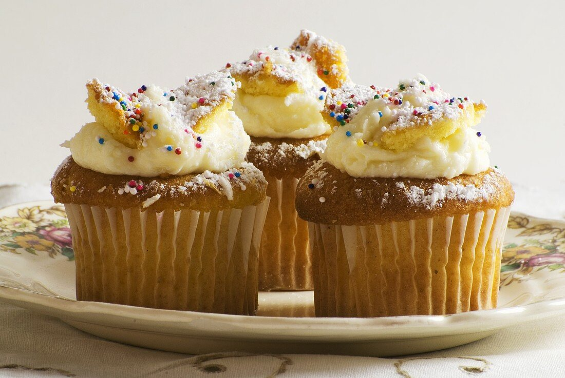 Three Frosted Cupcakes with Sprinkles on a Plate