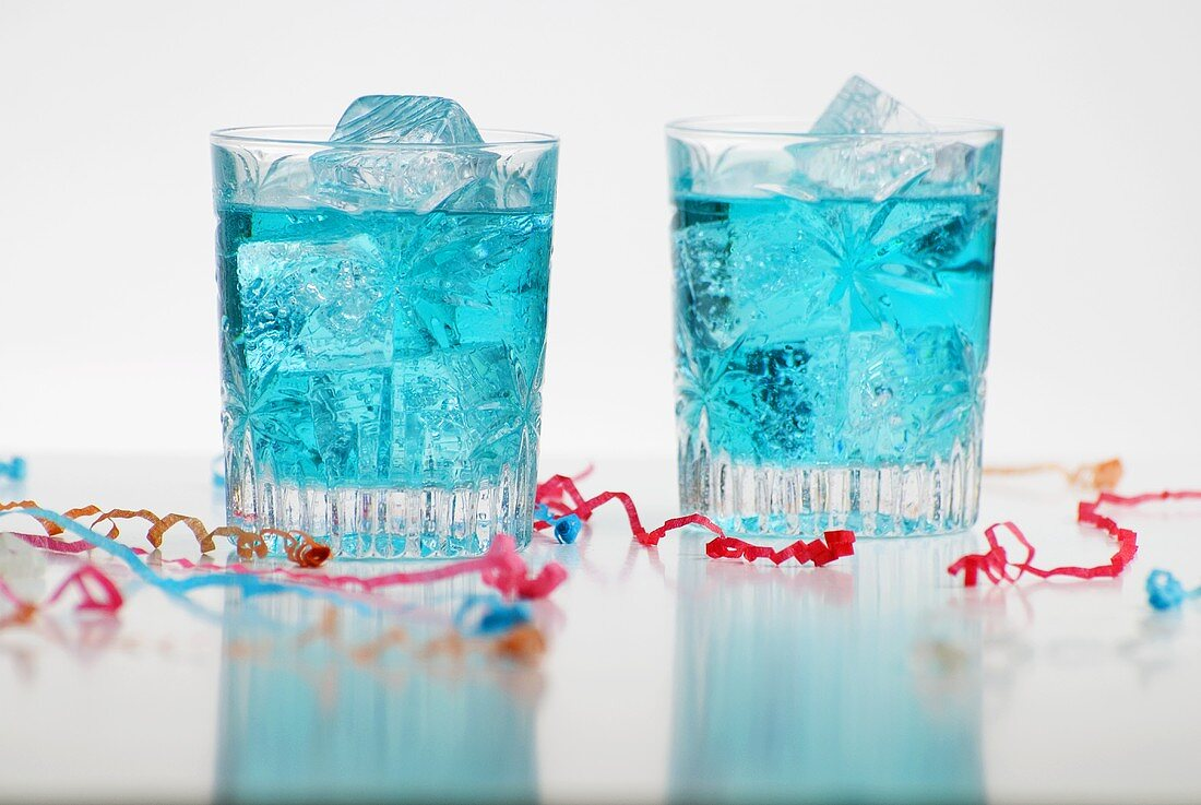 Two Blue Drinks with Ice; Party Streamers