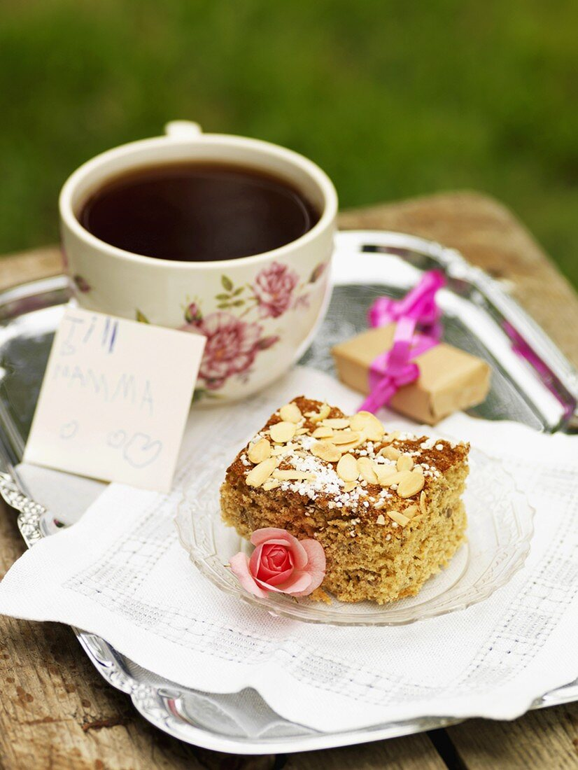 Piece of almond cake and coffee for Mother's Day