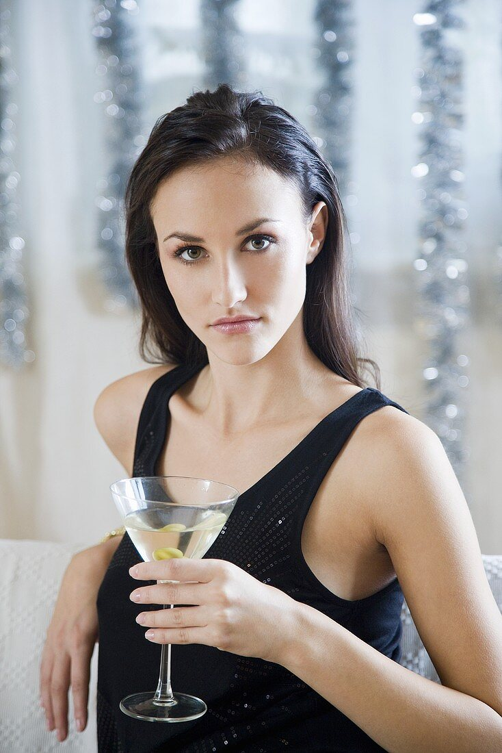 Young woman with a glass of Martini