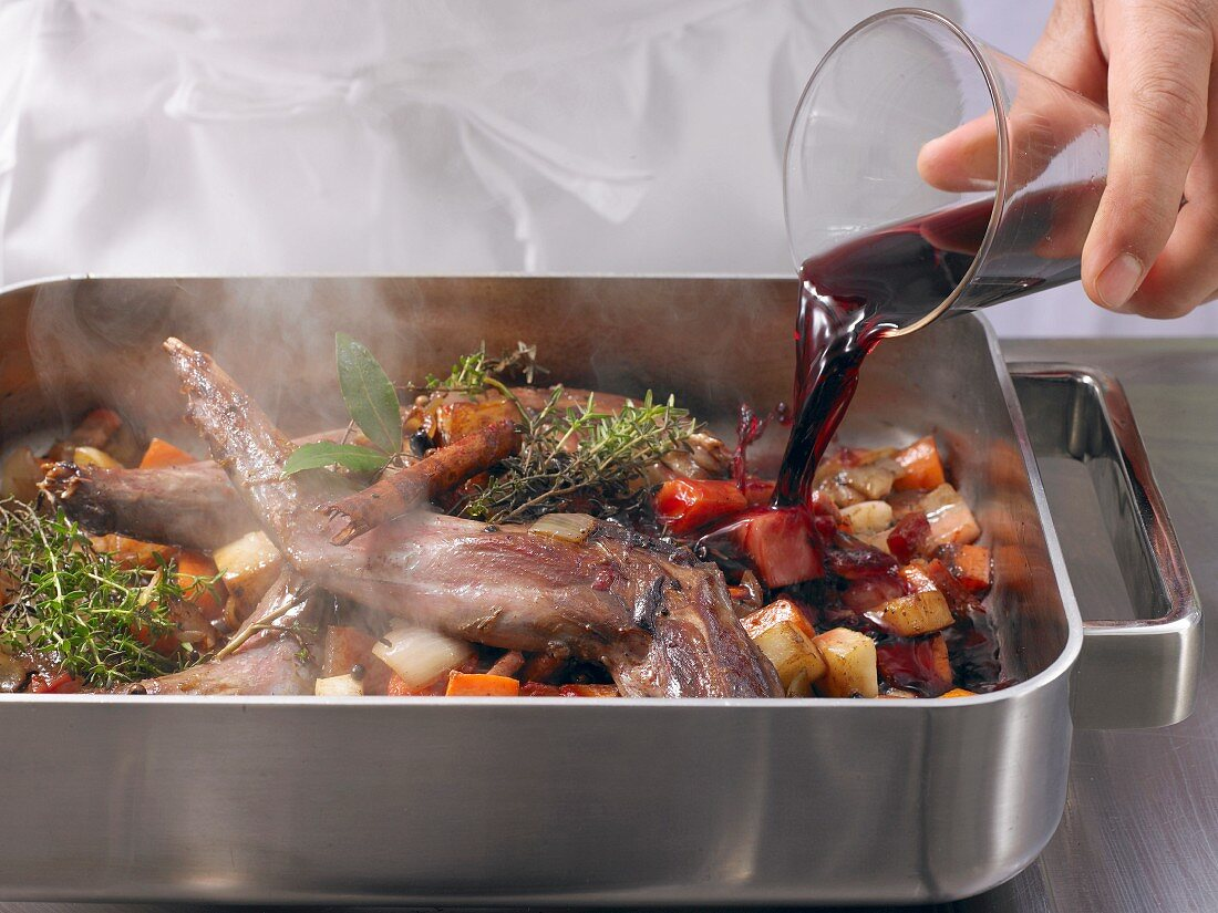 Roasted wild hare being basted with red wine