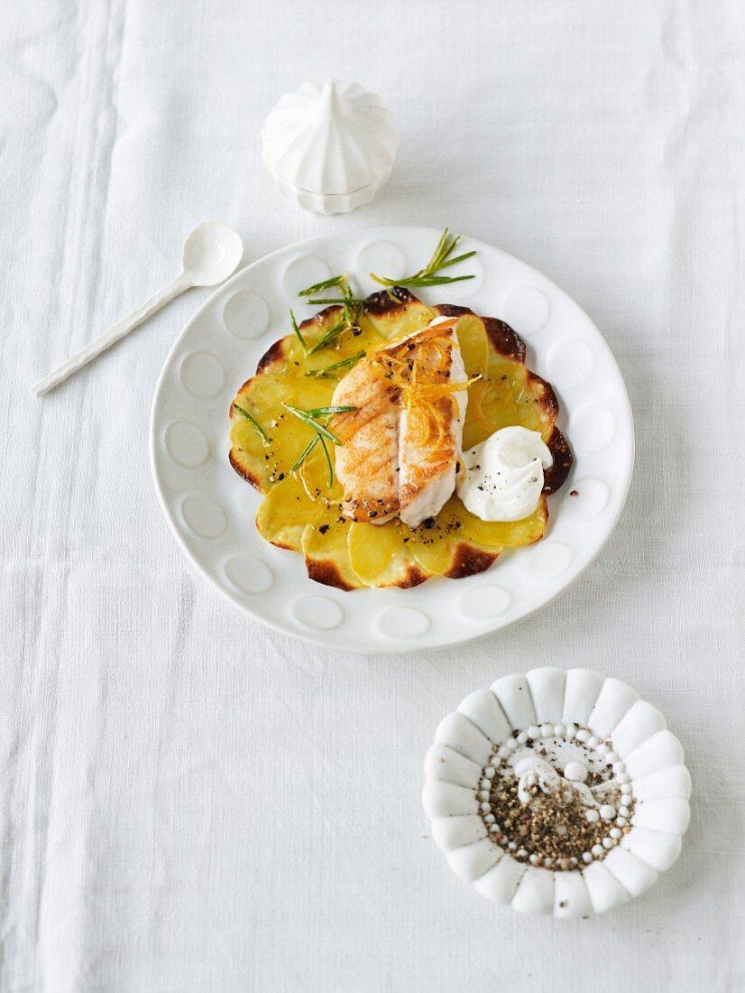 Potato carpaccio with rosefish fillet, creme fraiche and rosemary