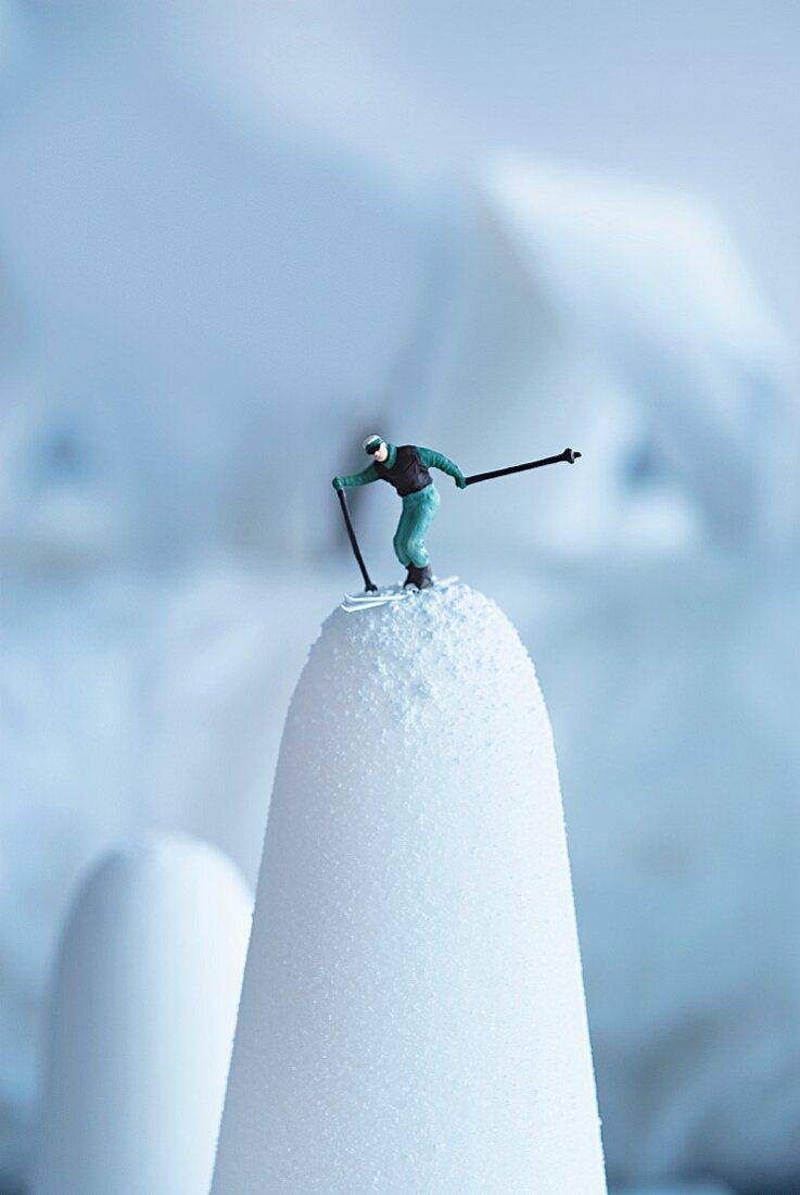 A skier figurine on sugar loaf