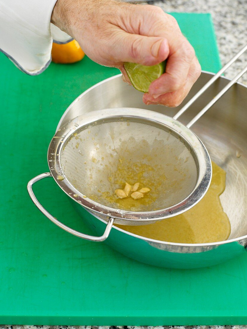 Line being pressed by hand through a sieve