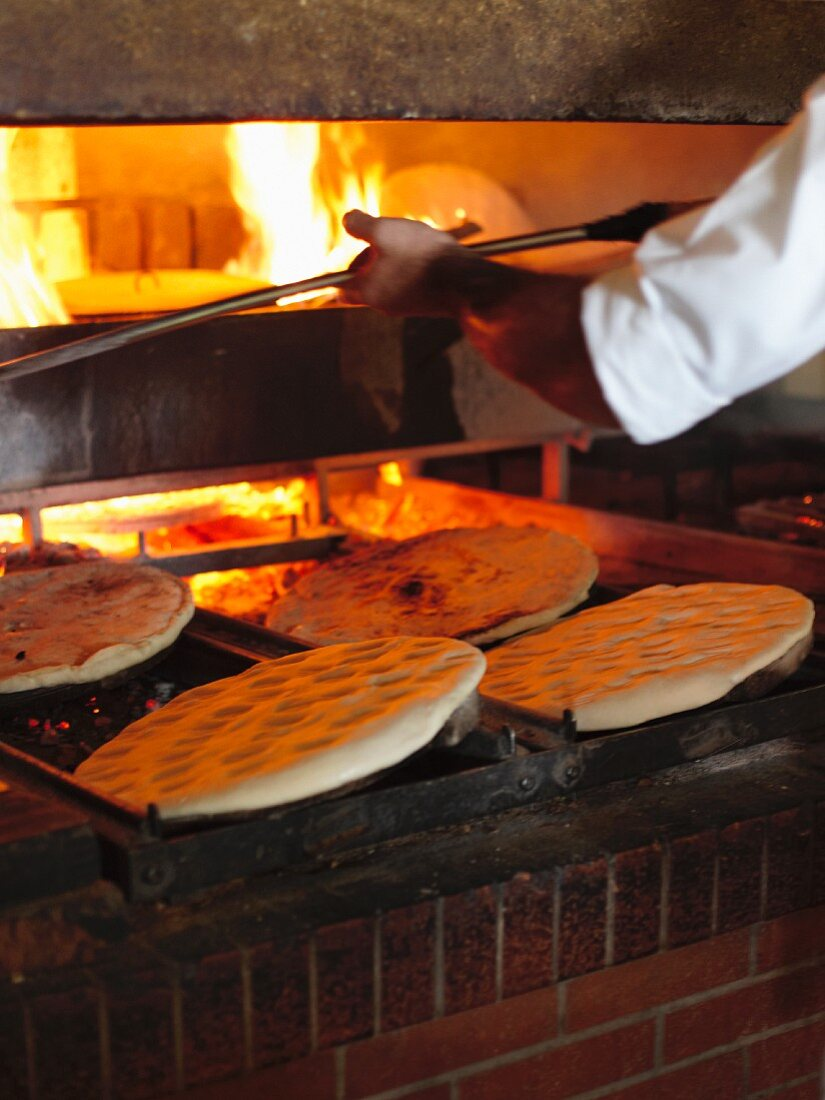 Unleavened bread in a stone oven (Umbria, Italy)