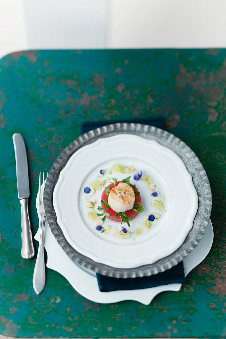 A fried scallop with watermelon jelly