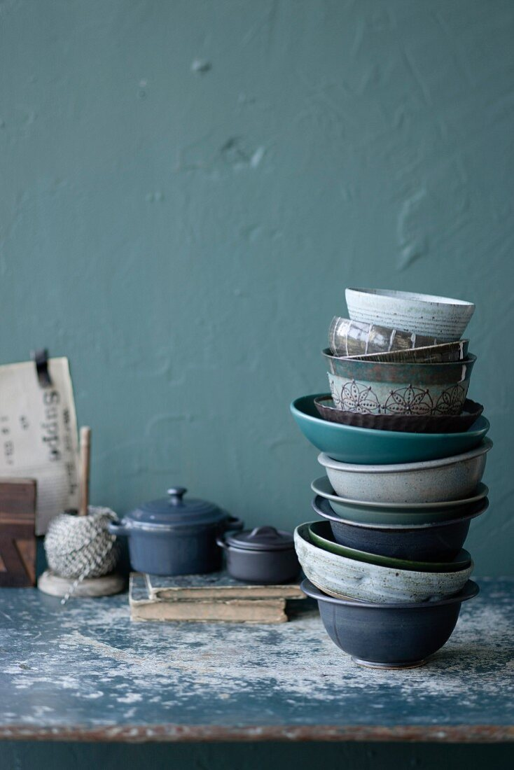 A stack of various different soup bowls