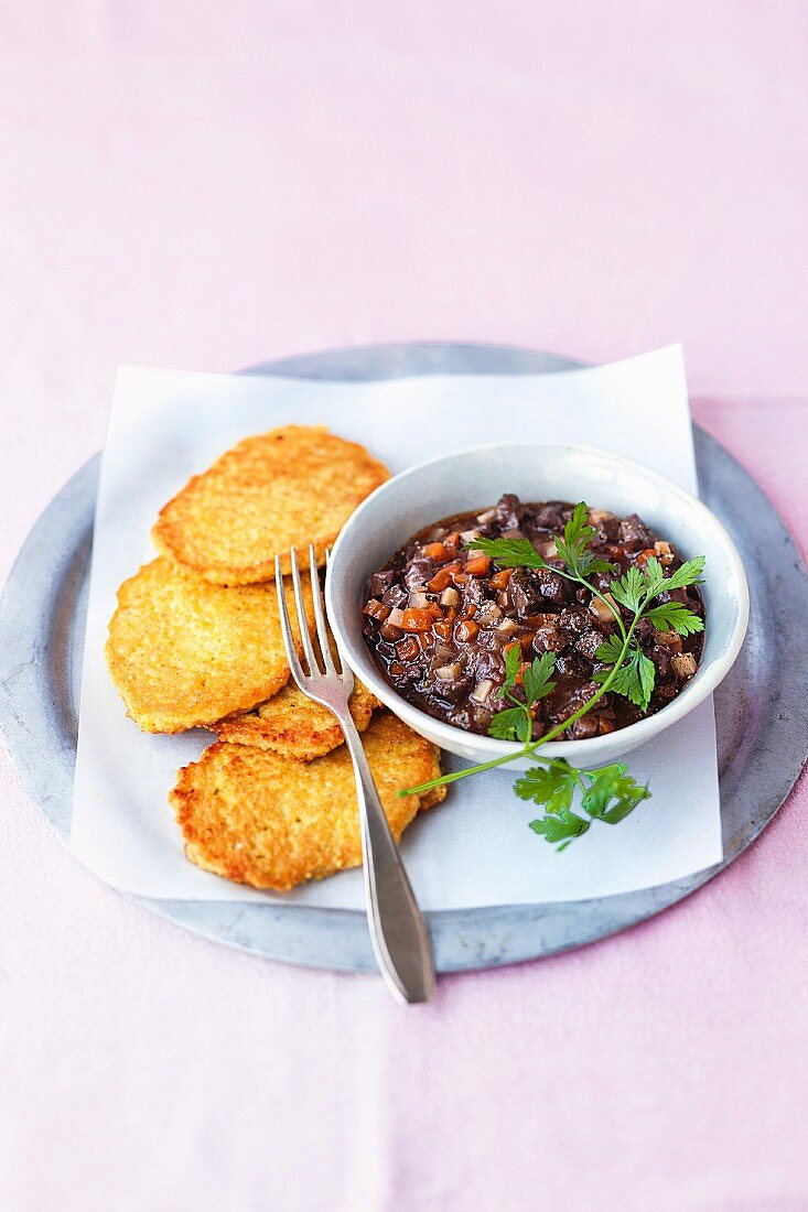 Duck ragout with millet cakes