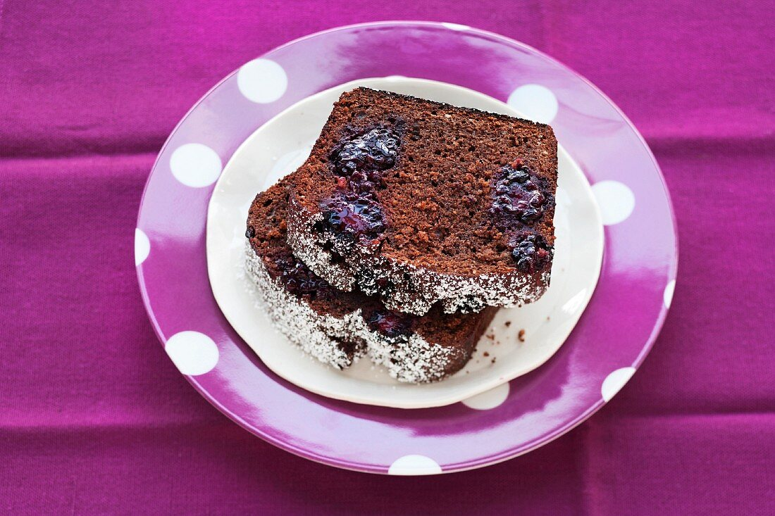 Two slices of chocolate and blackberry cake