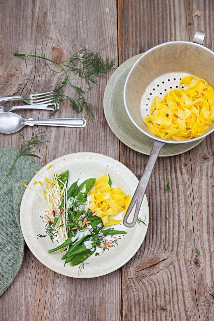 Saffron fettucine with a dill and coconut medley