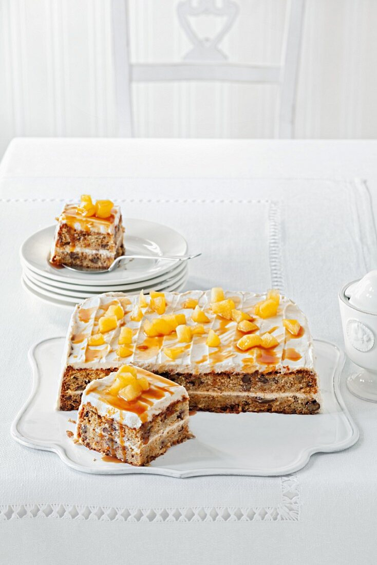 Apple cake with butter cream and caramelised apples