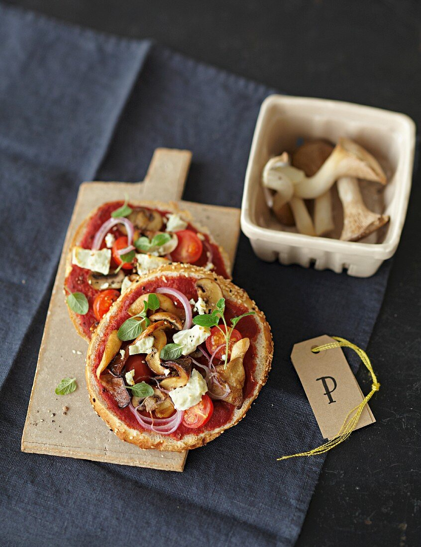Unleavened bread pizzas with mushrooms, tomatoes and sheep's cheese