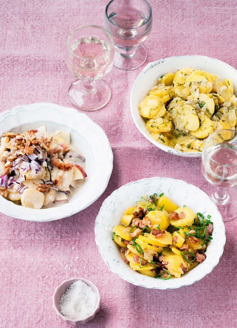 Three types of potato salad: with apple, with onions and with stock
