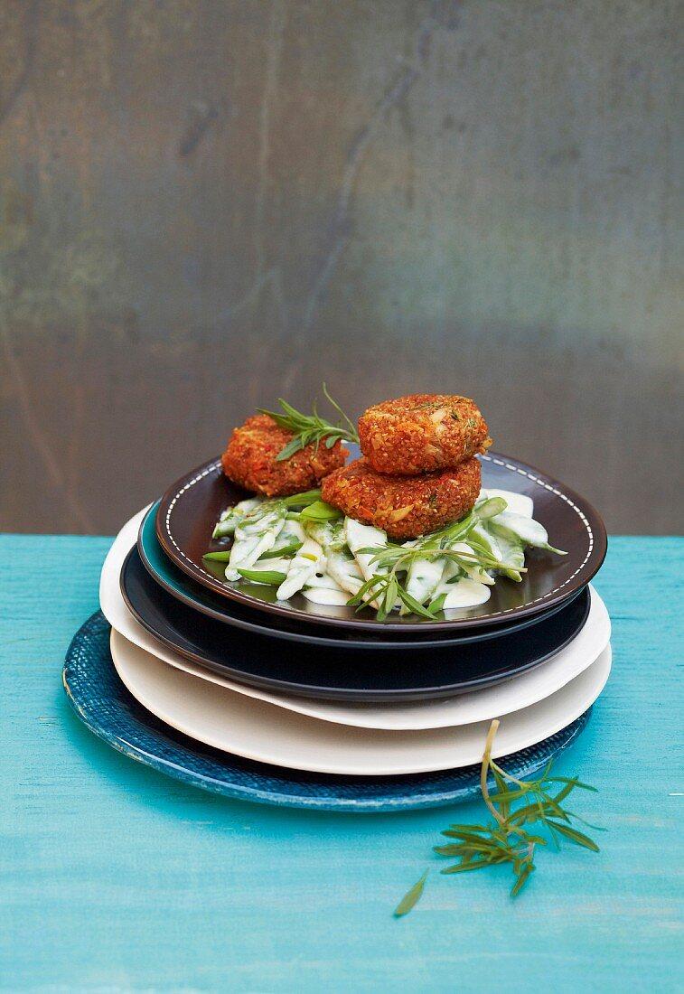 Cereal fritters on a bed of chopped beans
