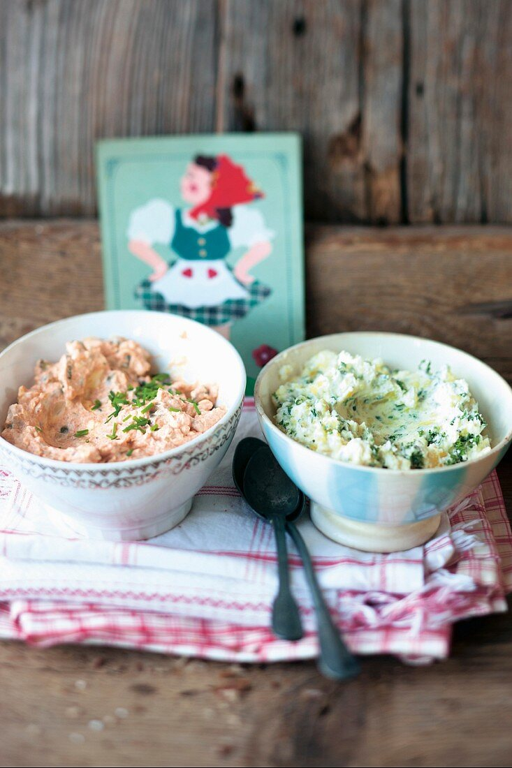 Bowls of Liptauer cheese spread and mashed potatoes with chives (Austria)