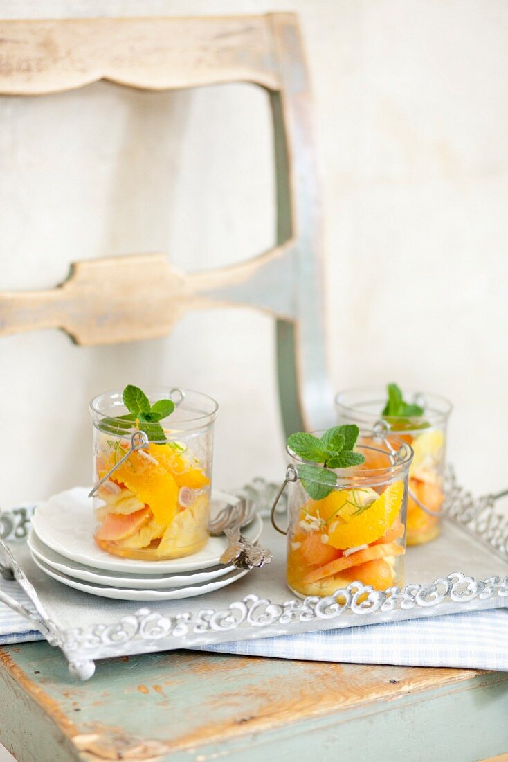 Exotic fruit salad made with oranges and papaya with fresh mint