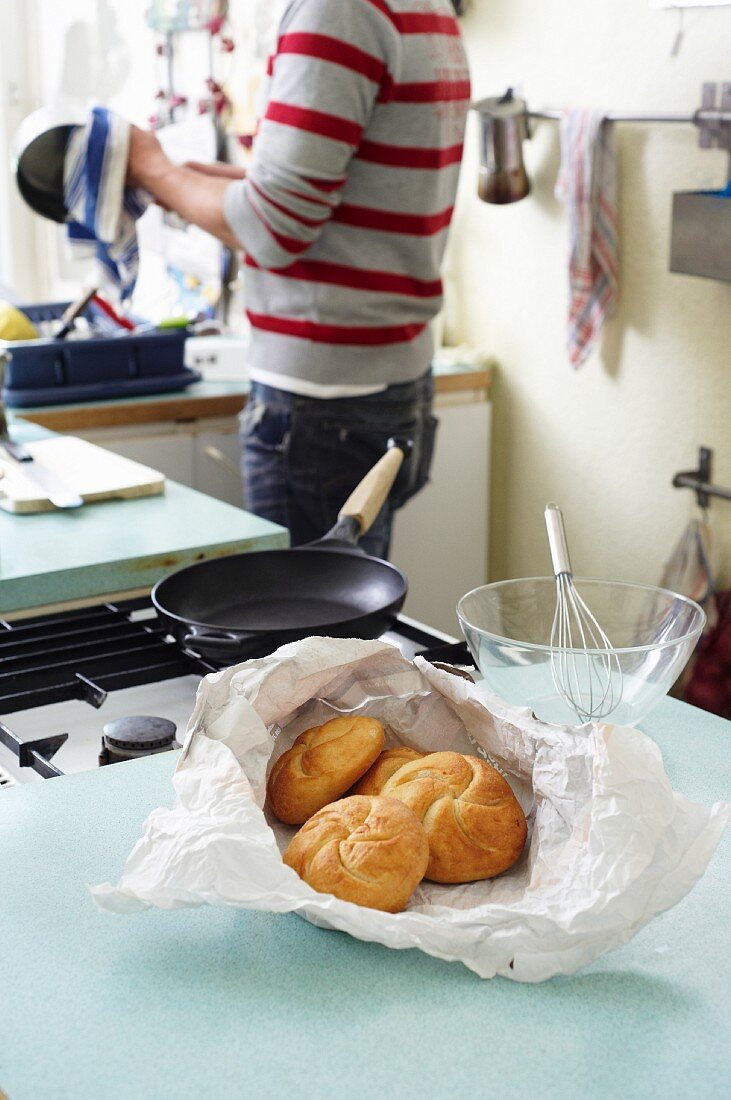 A bag of rolls in a student kitchen