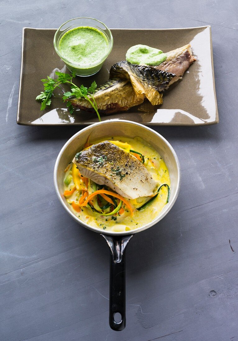 Smoked mackerel with a herb dip, and zander on a vegetable noodle nest