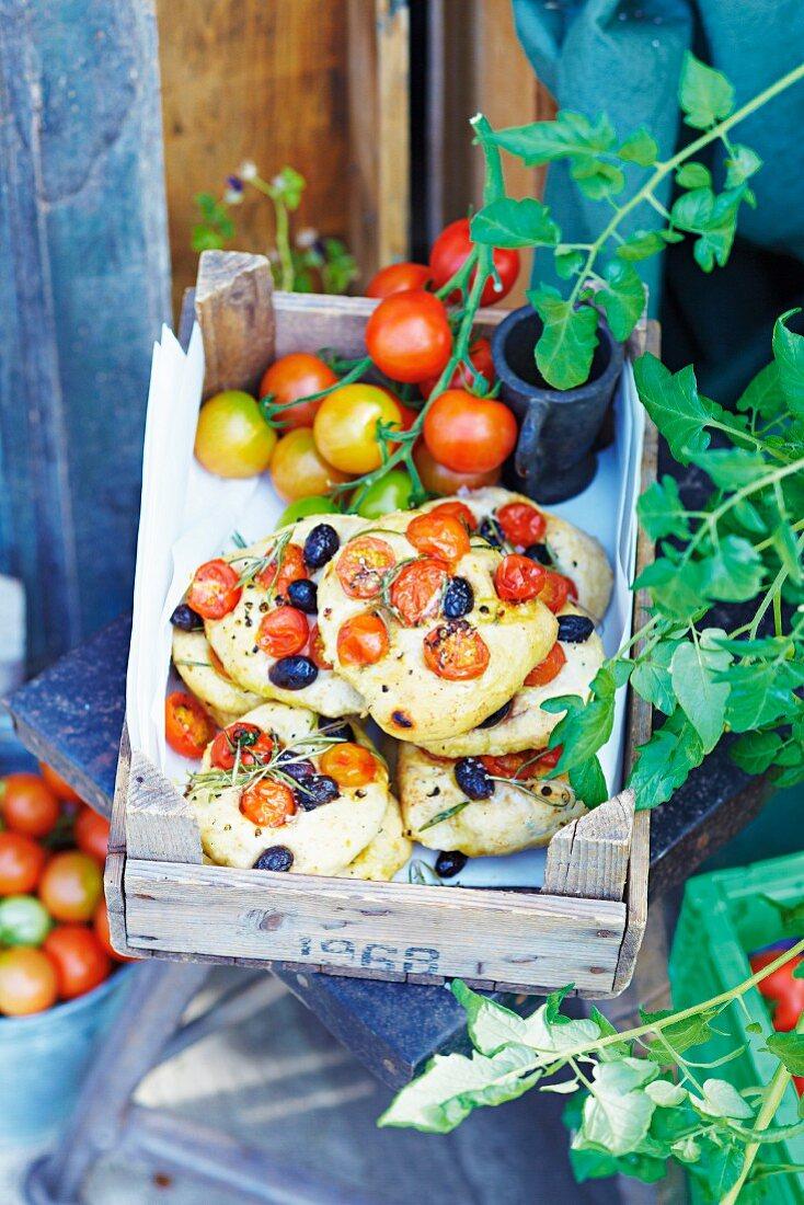 Mini tomato focaccias in an old fruit crate
