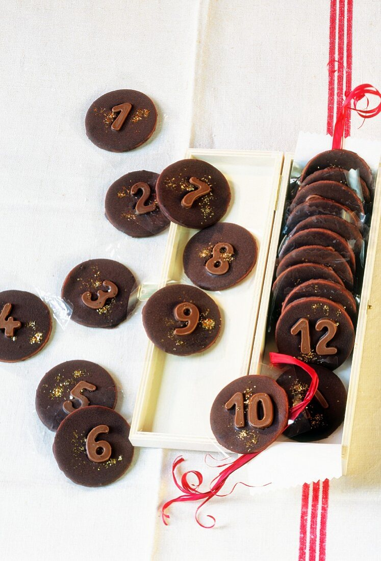 Chocolate peppermints decorated with numbers as an Advent calendar