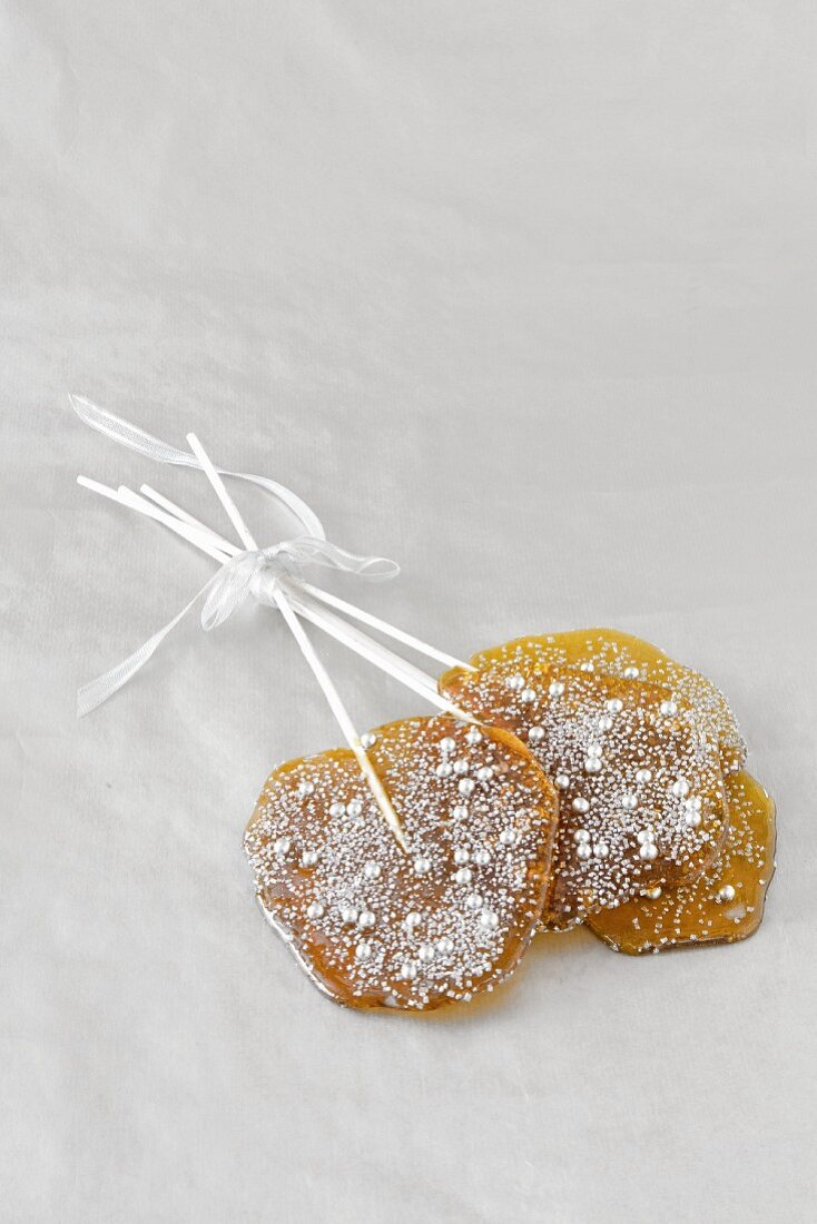Two home-made lollies with silver glitter, as gifts