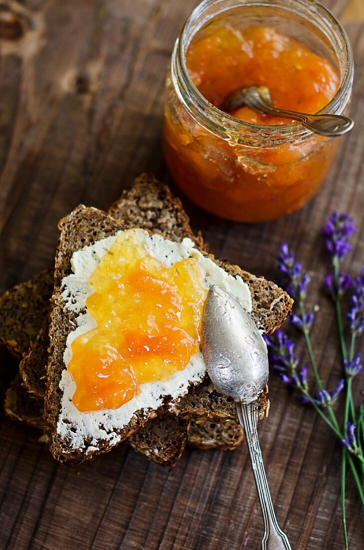 Wholemeal bread topped with cream cheese and melon jam