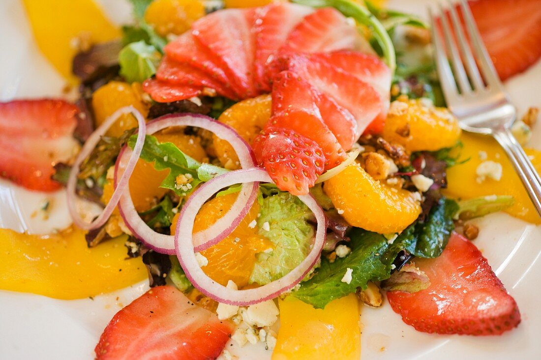 Fruit Salad with Sliced Strawberries, Mango, Mandarin Segments, Red Onion and Blue Cheese
