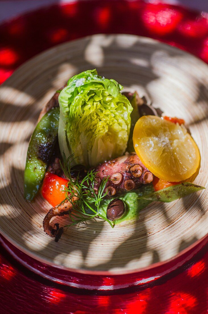 Warm vegetable salad with octopus