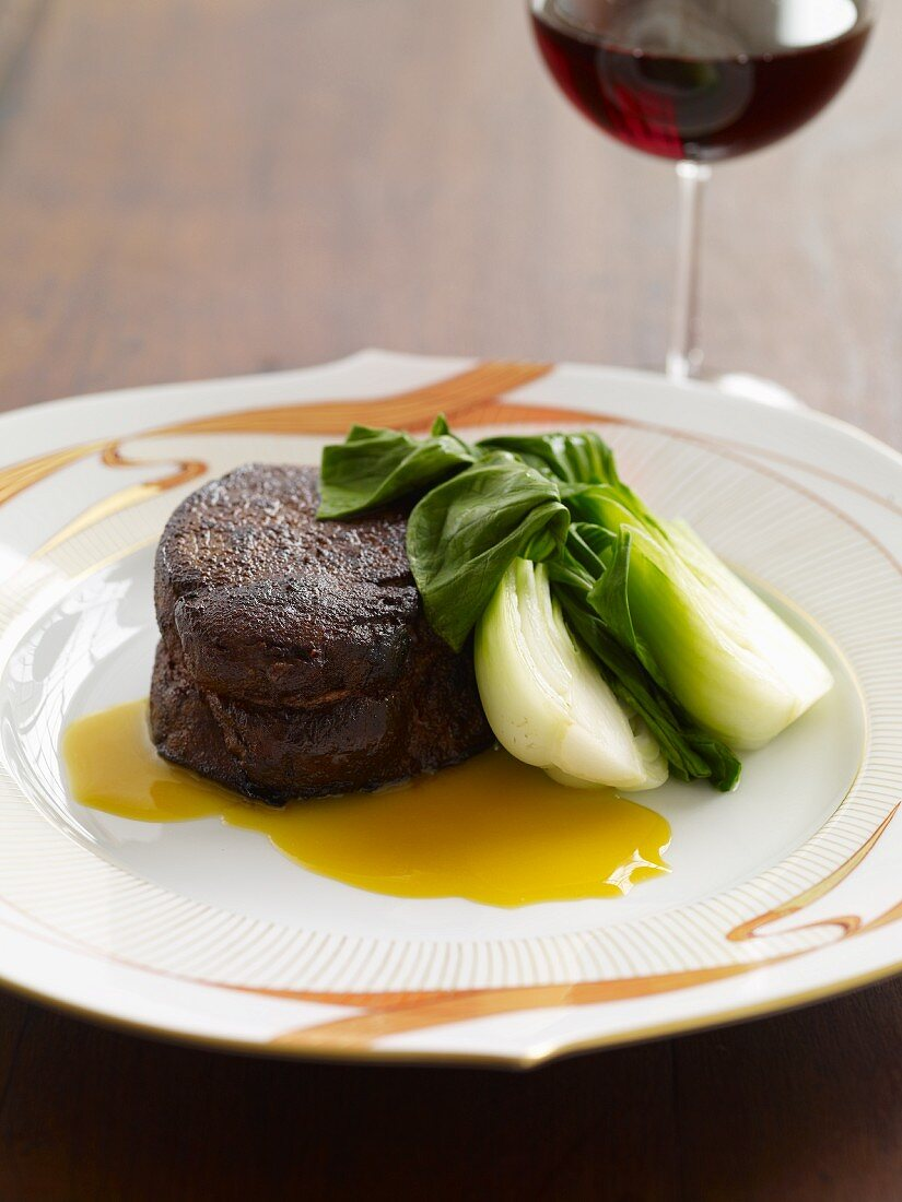 Beef Fillet with Baby Bok Choy; Glass of Red Wine