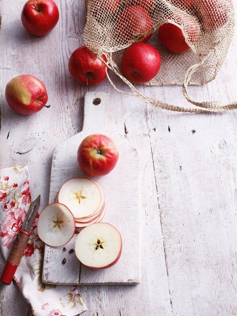 Sliced apples on wooden board