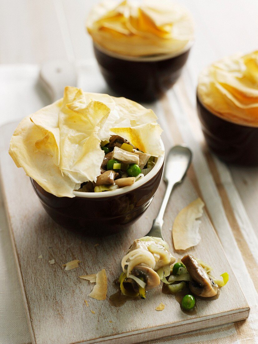 Bowl of pastry, chicken and vegetables