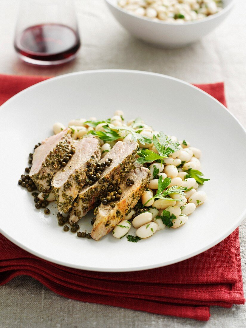 Plate of chicken with capers and beans