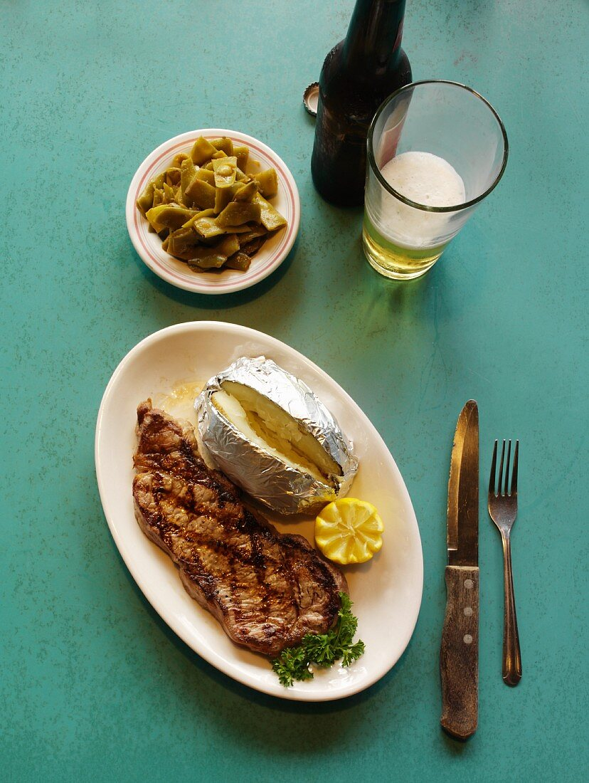 Grilled New York Strip Steak with Baked Potato and Beer