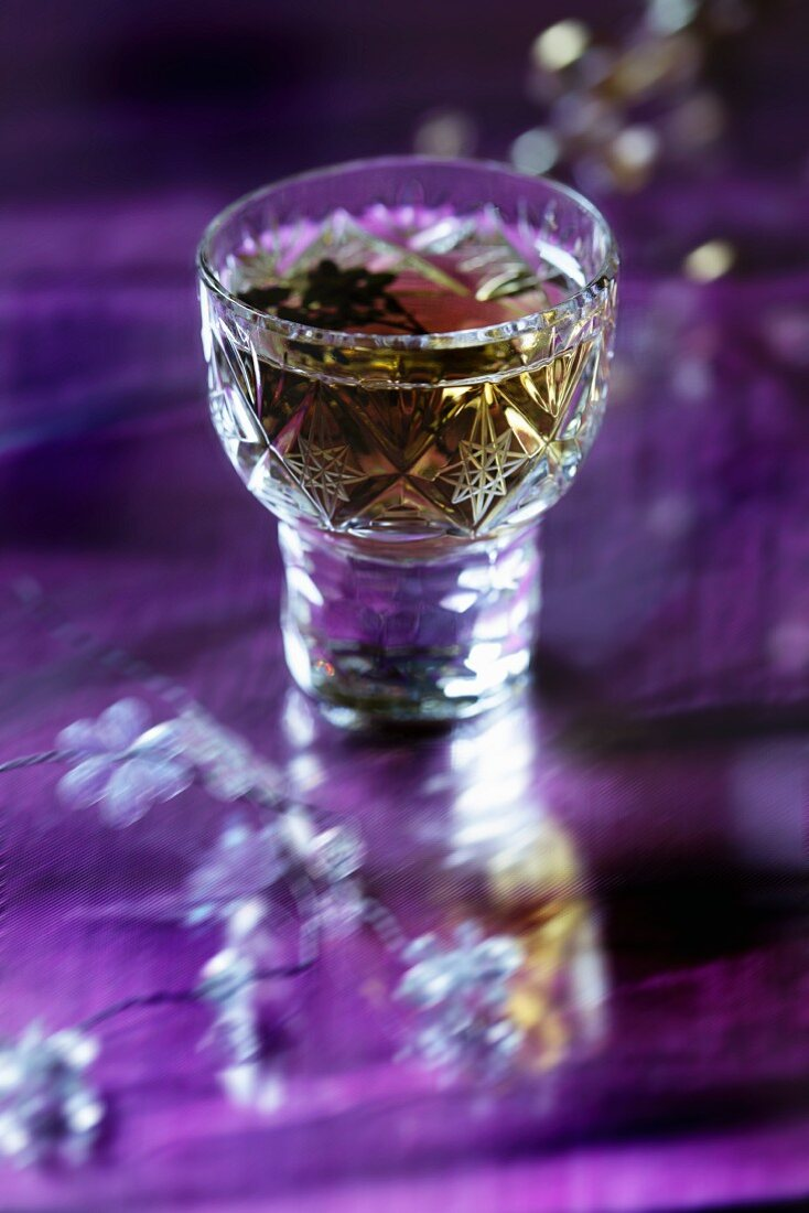 Thyme liqueur in a crystal glass