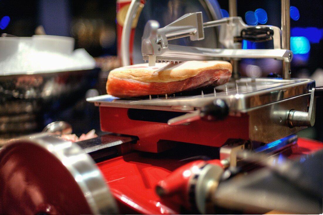Parma ham in a cutting machine