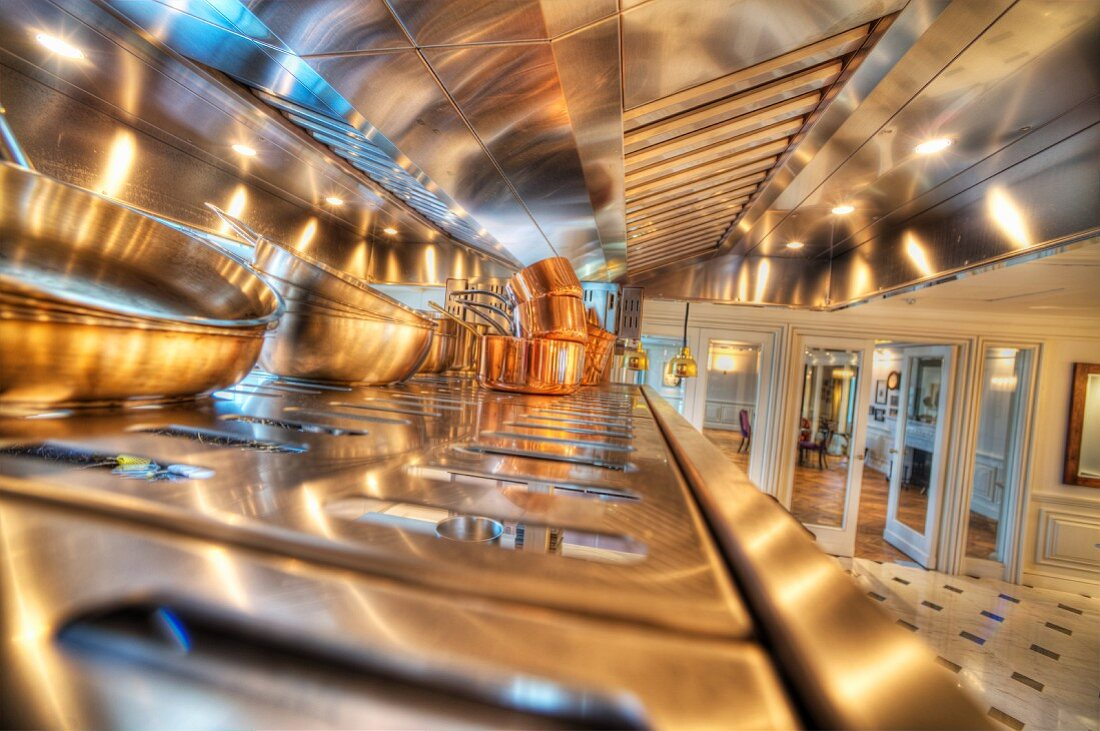 Copper pots in a stainless steel kitchen