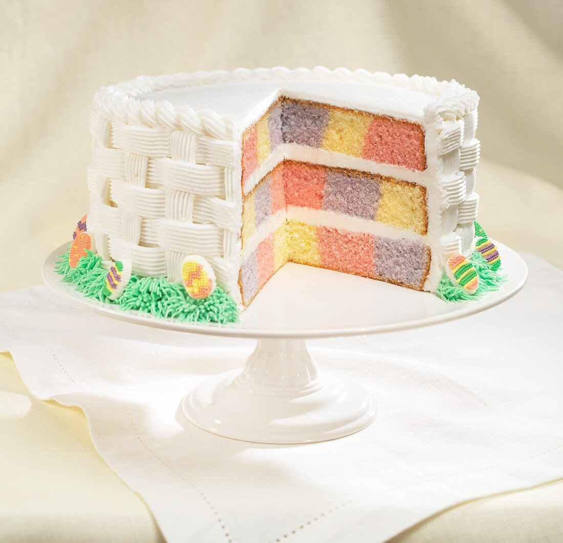 Battenburg cake decorated with white fondant icing for Easter