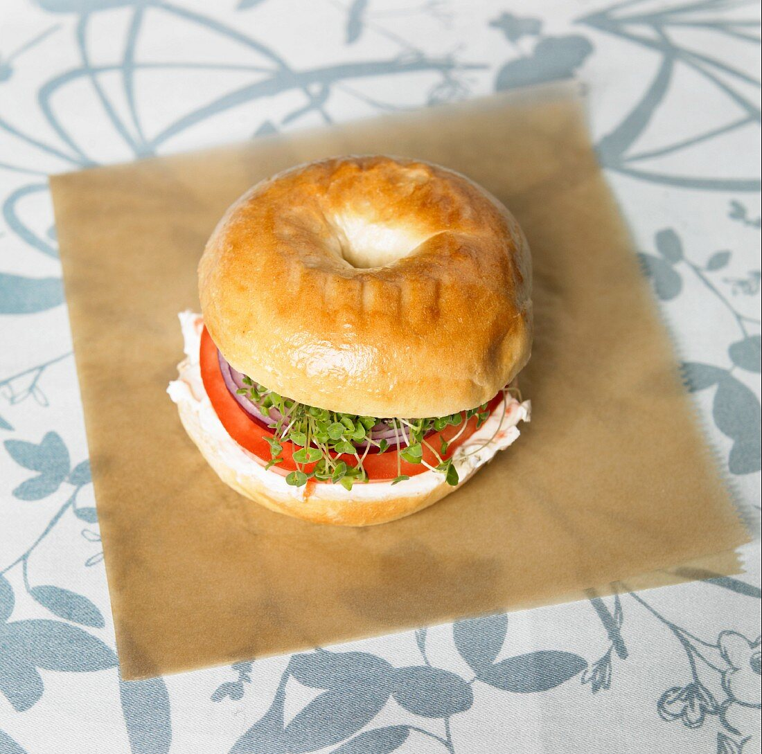 Organic Bagel Sandwich with Veggie Cream Cheese, Onion, Tomato and Chia Sprouts