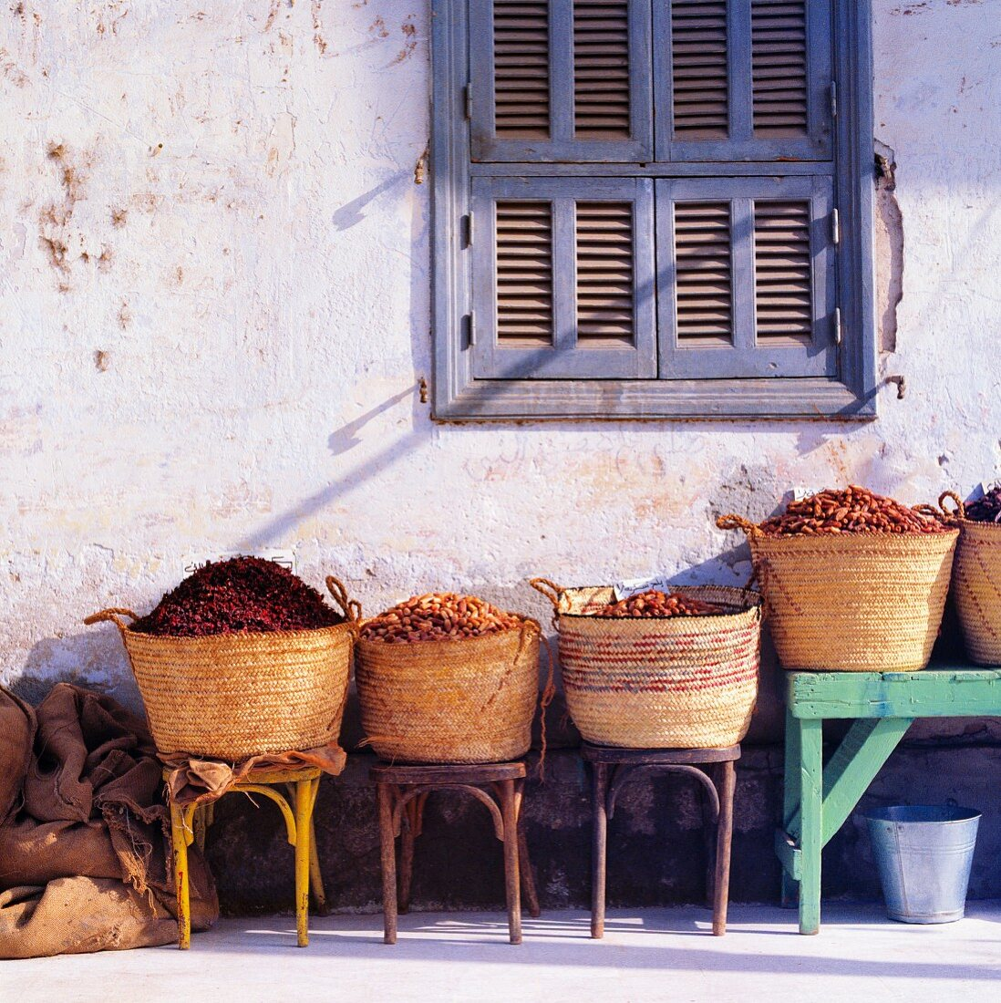 Baskets of dried food outside building