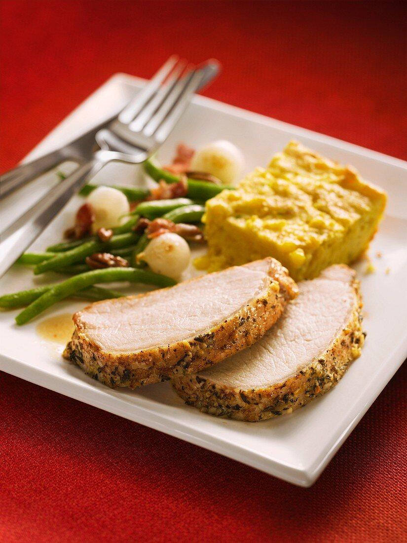 Sliced pork fillet with a mustard crust