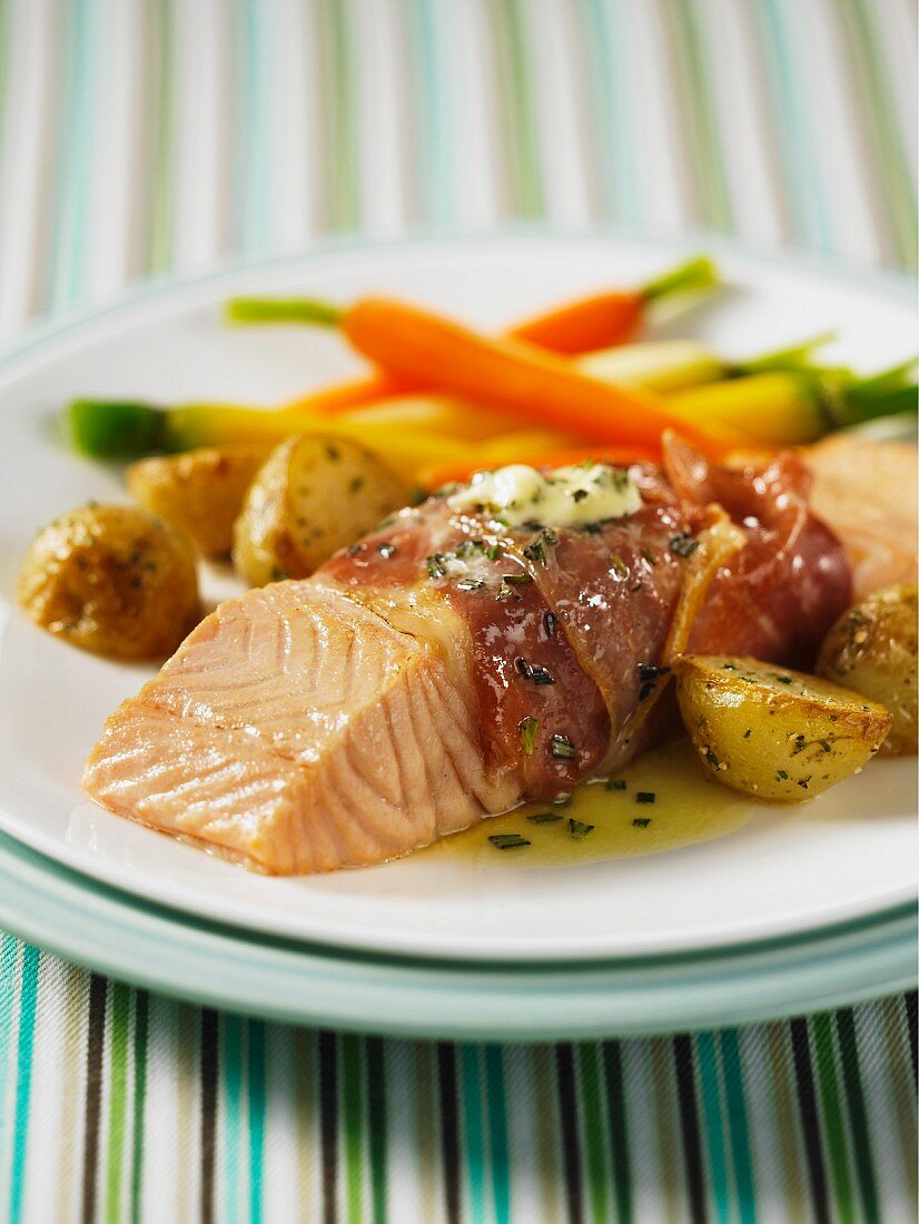 Salmon fillets wrapped in ham with new potatoes