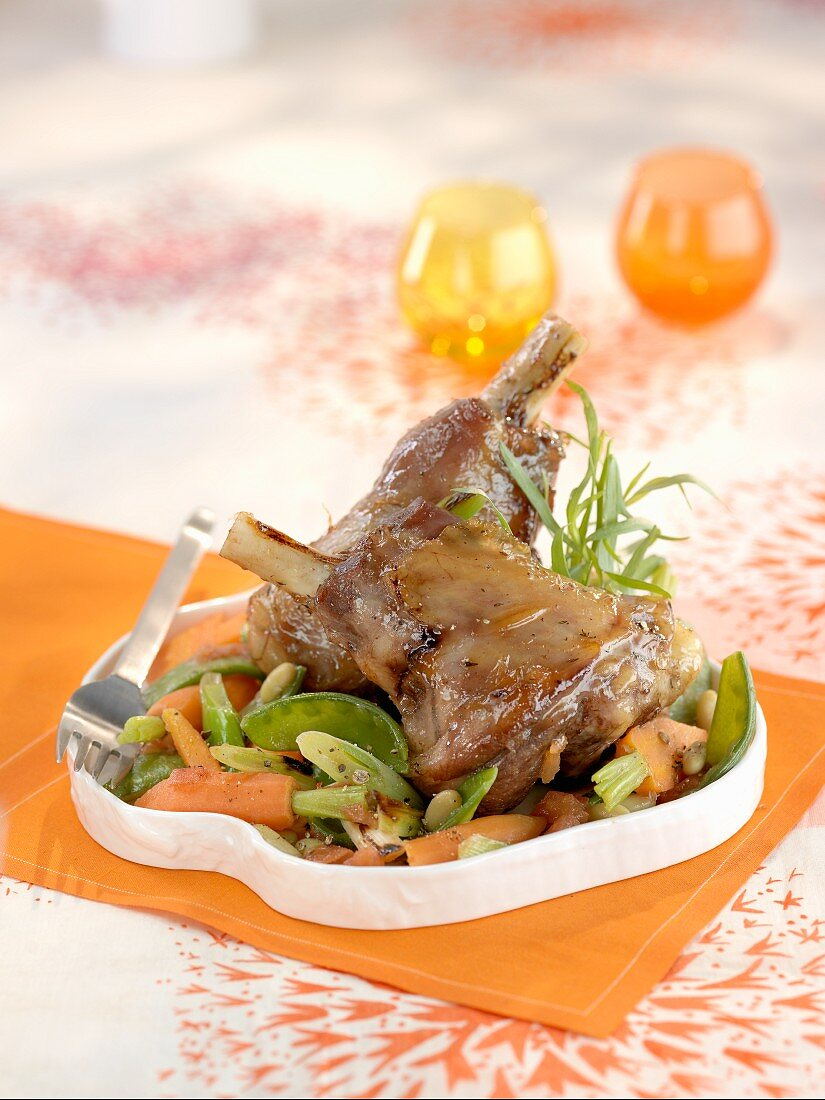 Lamb knuckle with spring vegetables and tarragon