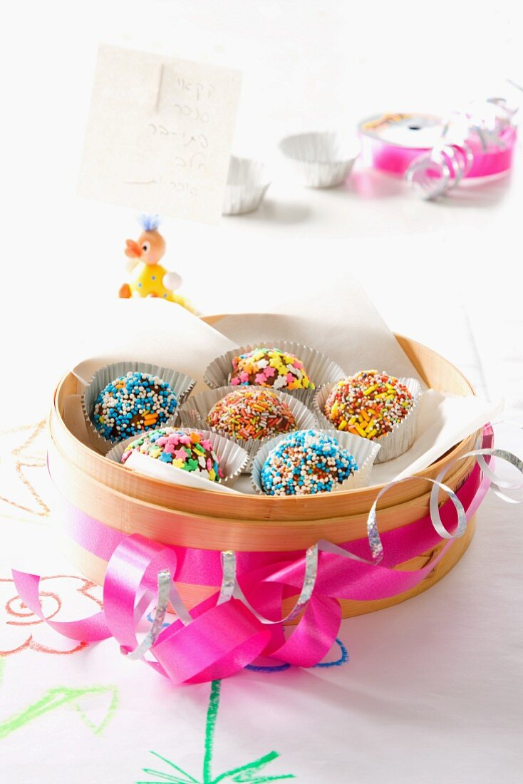 Chocolate balls decorated with colourful sugar sprinkles