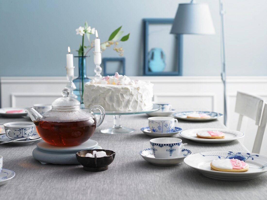 An East Frisian table laid for tea with place cards and a buckwheat cake with lingonberries