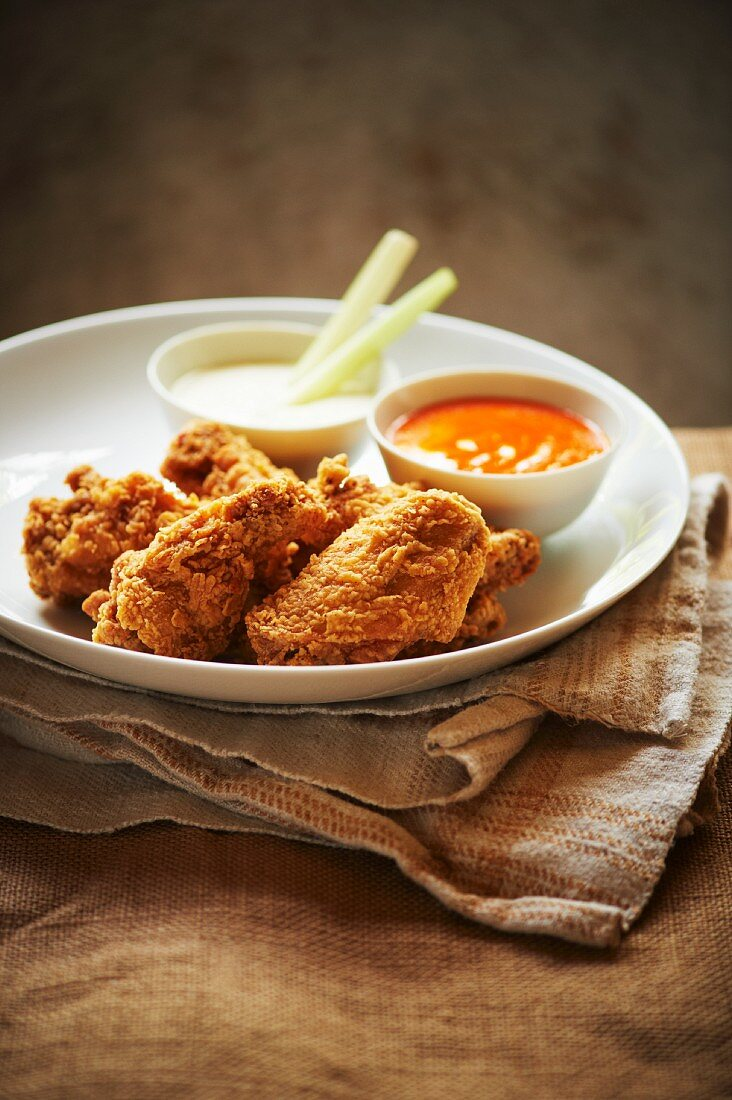 Fried Chicken Wings with Buffalo Sauce and Blue Cheese Dressing; Celery Sticks