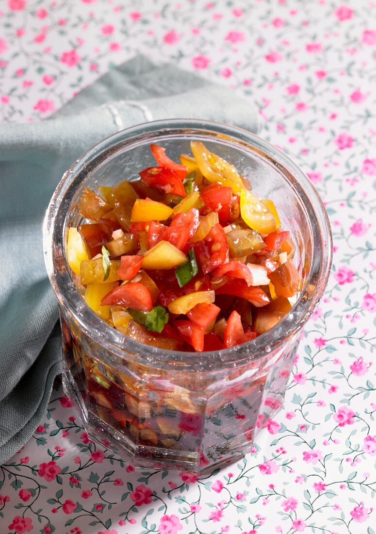 Sweet and sour vegetables in a glass with mango, pepper and aubergine