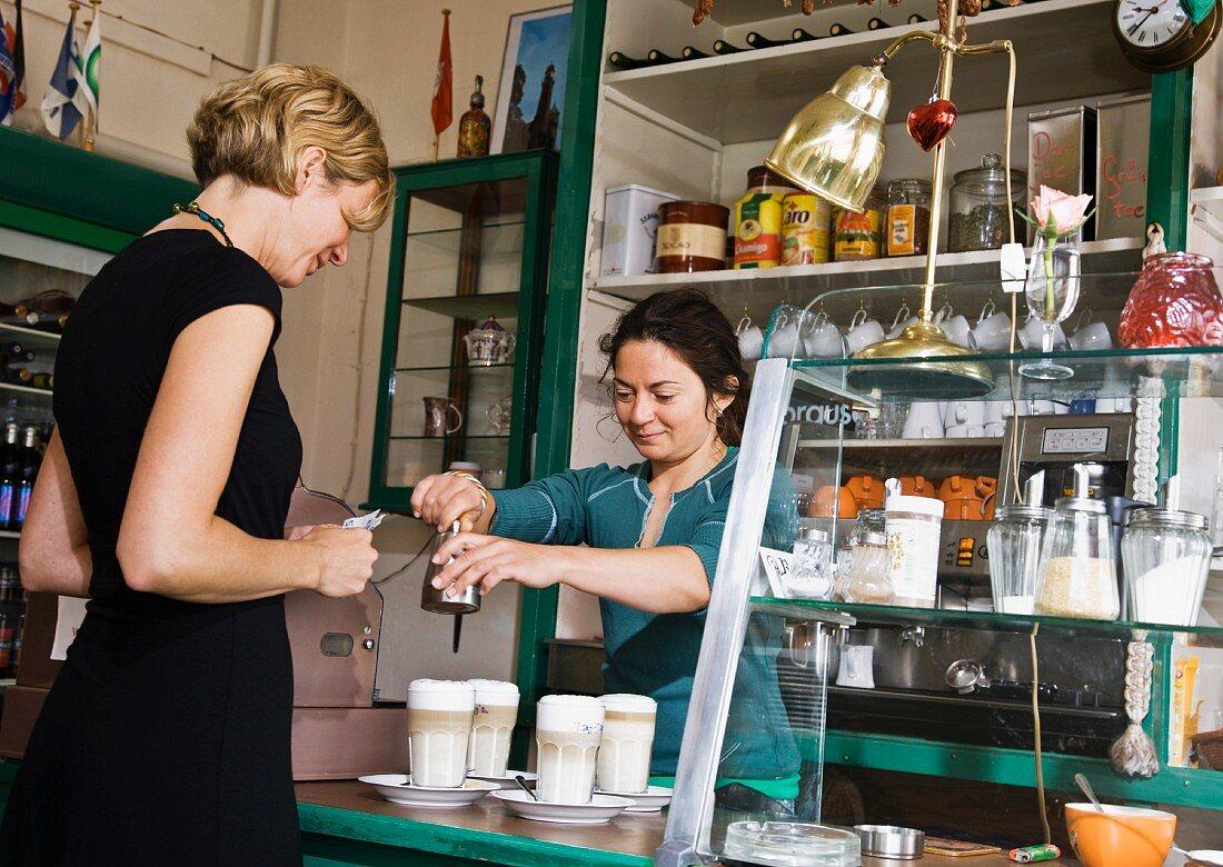 Female barista helping a female customer
