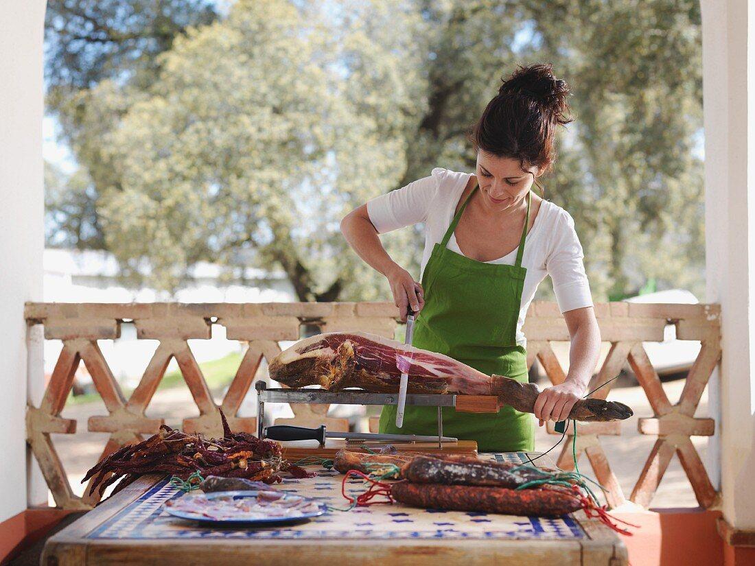 Woman slicing ham