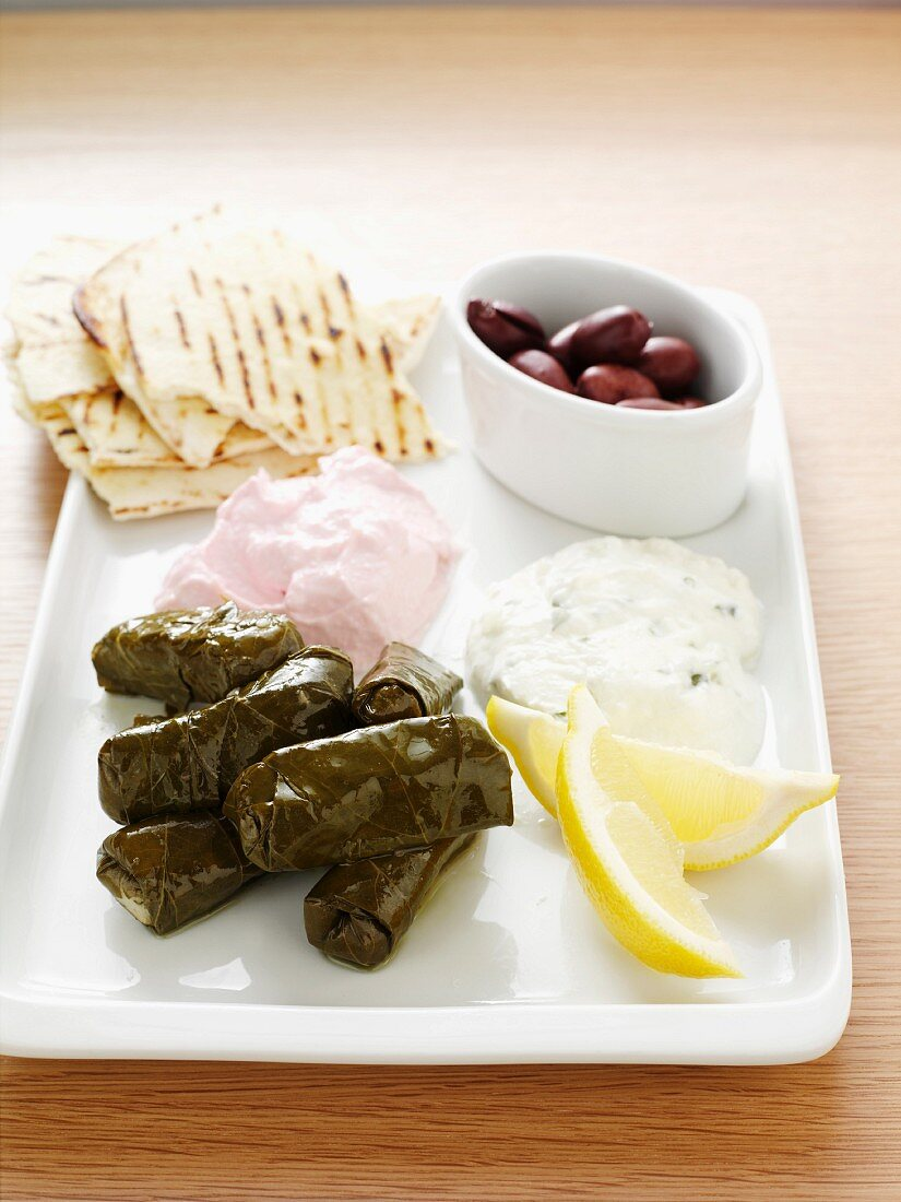 Starter plate with dolmades, tzatziki, tarama, olives and bread