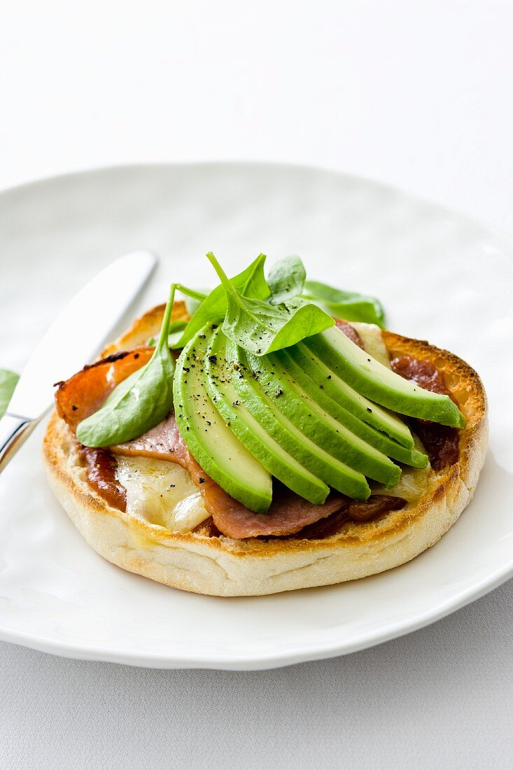 Cheese, bacon and avocado on an English muffin